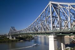 Story bridge and ferry. Ferry travelling under story bridge in australia Royalty Free Stock Photography