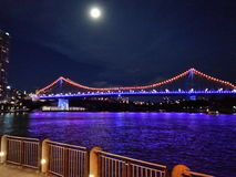 Story Bridge Lights under a Full Moon Stock Images