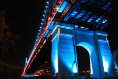 The Story Bridge supports at night time blue red Queensland Stock Photography