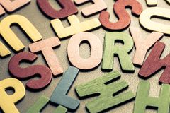 STORY. Closeup STORY word in scattered wood letters Stock Photo