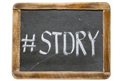 Story hashtag fr. Story hashtag handwritten on vintage school slate board isolated on white Stock Photography