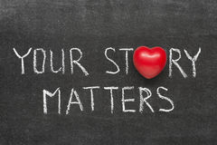Story matters. Your story matters phrase handwritten on blackboard with heart symbol instead of O Royalty Free Stock Photo