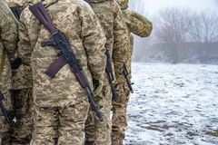 Story of military in camouflage with a firearm in winter.  stock images