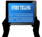 STORY TELLING on tablet screen, held by two hands. Stock Images