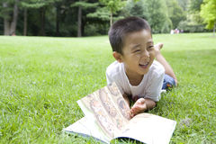 Story time. Reading book in a summer day Royalty Free Stock Photo