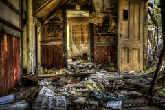 Story Time. Abandoned house with children books scattered on the floor. Urban Exploration Royalty Free Stock Images