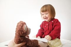Story time. Little girl playing school with toys teddy bear and doll.  children education and development, happy childhood royalty free stock image