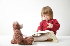 Story time. Little girl playing school with toys teddy bear and doll.  children education and development, happy childhood stock images