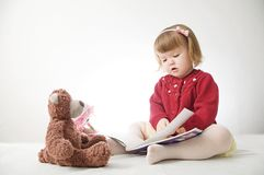 Story time. Little girl playing school with toys teddy bear and doll.  children education and development, happy childhood royalty free stock photo