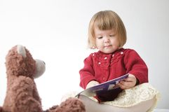 Story time. Little girl playing school with toys teddy bear and doll.  children education and development, happy childhood. Story time. Little girl playing royalty free stock photography