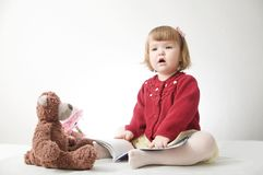 Story time. Little girl playing school with toys teddy bear and doll.  children education and development, happy childhood stock image