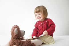 Story time. Little girl playing school with toys teddy bear and doll.  children education and development, happy childhood. Story time. Little girl playing royalty free stock photo
