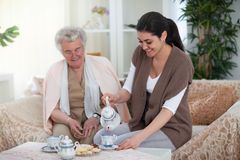 Story time with tea at grandma`s Stock Image