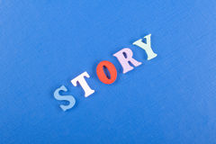 STORY word on blue background composed from colorful abc alphabet block wooden letters, copy space for ad text. Learning Royalty Free Stock Photos