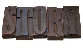 Story - word in letterpress type. Story - word in antique wooden letterpress printing blocks, stained by dark color inks, isolated on white Stock Photo
