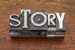 Story word in metal type. Story word in vintage metal type printing blocks over grunge wood Royalty Free Stock Image
