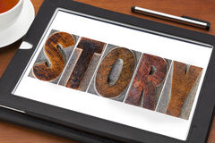 Story word on tablet Stock Photo