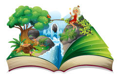 A storybook with an image of nature and a fairy Stock Photography
