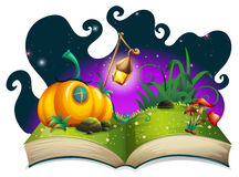 Storybook with pumpkin house at night Royalty Free Stock Images