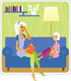 Storytelling. Young mother reading book to her daughter Stock Images