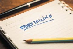 Storytelling. Handwriting of Storytelling text on notebook Stock Photo