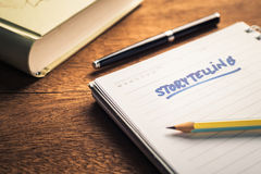 Storytelling. Handwriting of Storytelling text on notebook on the desk Royalty Free Stock Photo