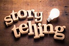 Storytelling Idea. Wood Storytelling word with glowing light bulb. Storytelling idea stock photos