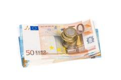 Stos banknoty wystawia rachunek euro i stos monety Fotografia Royalty Free