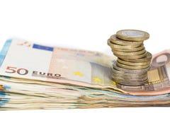 Stos banknoty wystawia rachunek euro i stos monety Zdjęcia Royalty Free