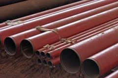 Stos czerwony przewód instalować na budynku Obraz Royalty Free