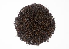 Stos kawowe fasole w białym tle odizolowywającym zdjęcia stock