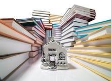 Stos książki i dom Zdjęcie Stock