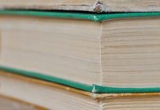 Stos książki na drewnianym tle Obraz Royalty Free