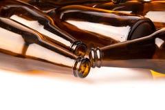 Stos piwna butelka na białym tle Obrazy Royalty Free