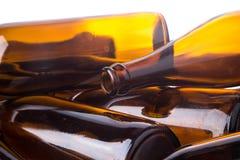 Stos piwna butelka na białym tle Obrazy Stock