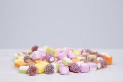 Stos różnorodna miękka część i chewy cukierki na popielatym Obrazy Stock