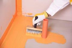 stosować szczotkarski rękawiczkowy ręki waterpro kolor żółty fotografia royalty free
