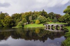 Stourhead Gardens. Lake and bridge at Stourhead in Wiltshire Royalty Free Stock Photo