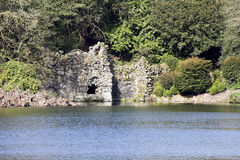 Stourhead grotto viewed from across the lake Royalty Free Stock Photography