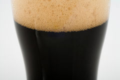 Stout Beer. A pint of stout beer close up Stock Images