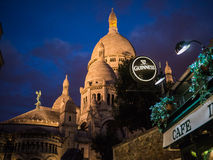 Stout beer sign in foreground, illuminated Sacre C Royalty Free Stock Photos