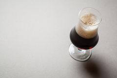 Stout on gray Royalty Free Stock Images