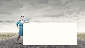 Stout woman with banner Royalty Free Stock Image