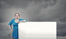 Stout woman with banner Royalty Free Stock Photography