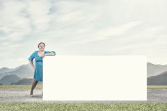 Stout woman with banner Stock Photography