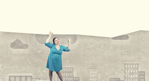 Stout woman with banner Royalty Free Stock Photo