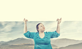Stout woman with banner Stock Image