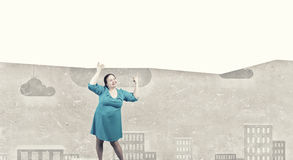Stout woman with banner Royalty Free Stock Photos