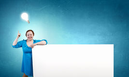 Stout woman with banner Stock Photo