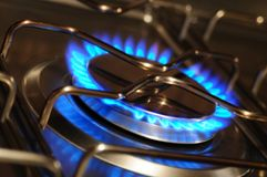 Stove. Domestic kitchen stove with blue flame Stock Photos